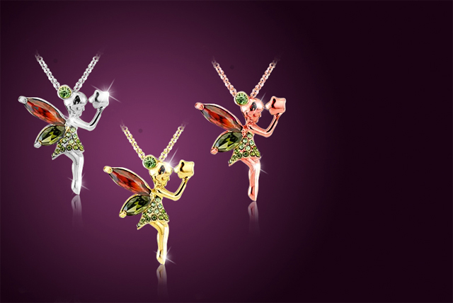 Whether you opt for a rhodium, gold or rose gold-plated fairy, you'll find her encrusted with emerald-coloured crystals and holding a star pendant.