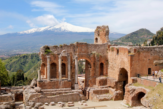 With Mount Etna in the background,  Taormina's ancient Greek theatre  makes for a must-see site.
