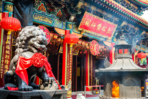 Burning incense in Wong Tai Sin Temple in Hong Kong